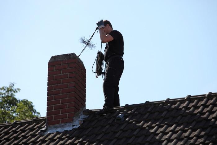 male checking Chimney