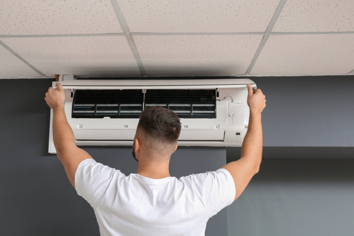 male installing and checking split ac