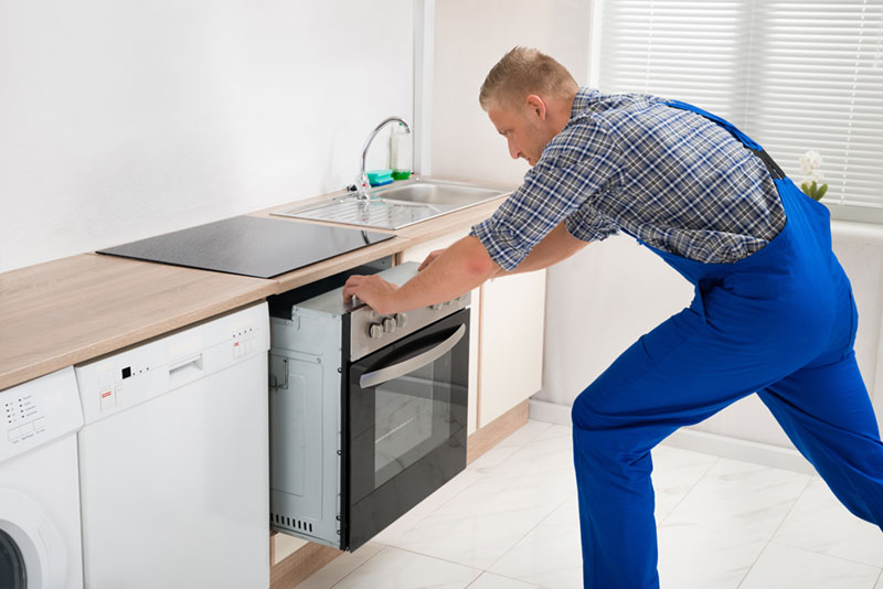 removing oven from wall