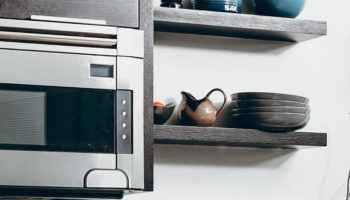 A Microwave Oven In A Kitchen Shelf