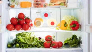 A refrigerator with lots of food inside