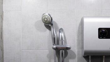 A water heater in a bathroom wall