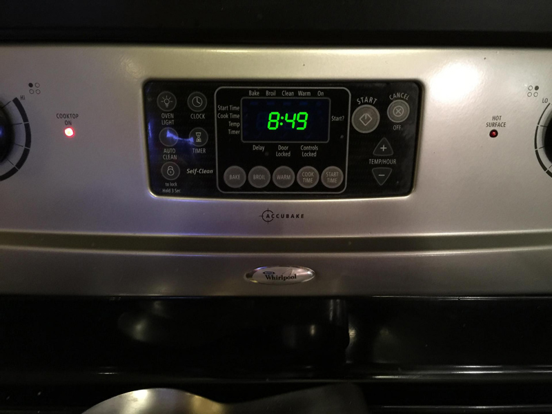 Front of a Whirlpool oven with digital control panel.